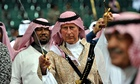 Prince Charles performs a traditional Saudi dance in Riyadh, Saudia Arabia.