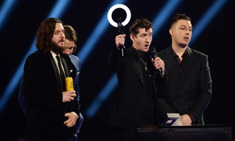 Arctic Monkeys accept British Group Award.