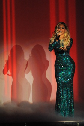 Triple whammy: Beyonce performs.