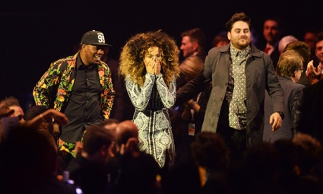 Ella Eyre, DJ Locksmith and Kesi Dryden of Rudimental react to their British Single Award. Photograph: Dave J Hogan/Getty Images