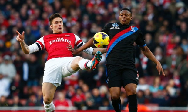 Arsenal's Olivier Giroud, left, challenges Kagisho Dikgacoi of Crystal Palace at the Emirates.