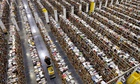 An Amazon.com employee walks down one of the miles of isles at an Amazon.com Fulfillment Center