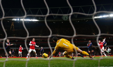 Alex Oxlade-Chamberlain fires home his and Arsenal's second.