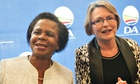 Mamphela Ramphele dances as she stands next to Helen Zille