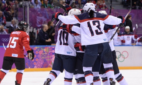 USA celebrate their first.