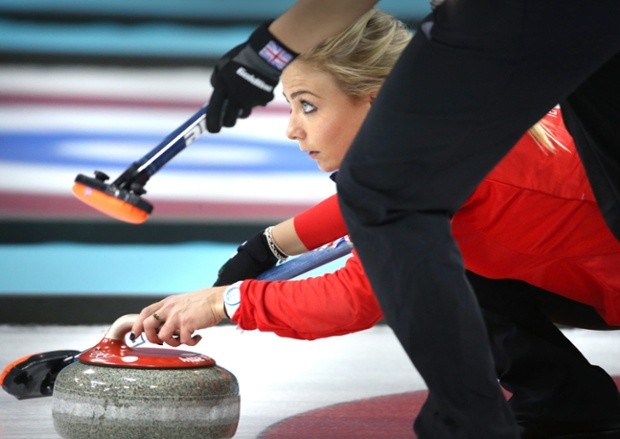 Anna Sloan of Great Britain has her eye on a bronze medal as she sets up the stone in the women's curling competition in the Ice Cube Curling Center.
