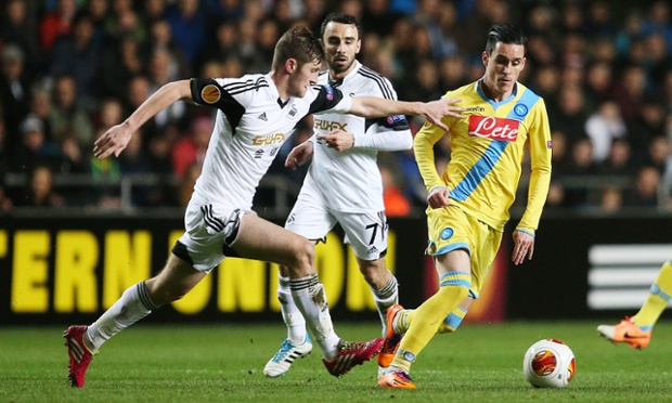 Napoli's Jose Callejon (R) fights for the ball with Swansea's Ben Davies.