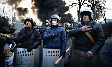 Anti-government protesters man the front line on Kiev's Independence Square