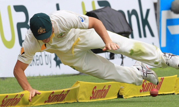 Australia's David Warner dives to save the ball on day two against South Africa.