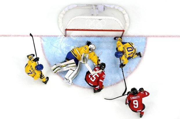 Valentina Lizana Wallner of Sweden makes a save against Alina Muller of Switzerland during the bronze medal goal.