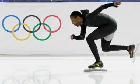 Shani Davis of the US skates in a unmarked prototype suit during a training session at the Adler Arena in Sochi, Russia..