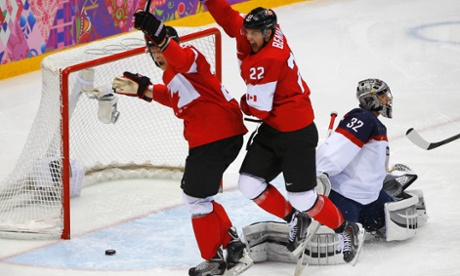 Canada's Jamie Benn celebrates a goal against Team USA's goalie Jonathan Quick during their men's ice hockey semi-final.