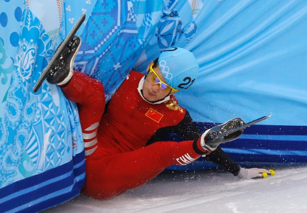 Liang Wenhao of China crashes out in the men's 500m short track speedskating final.