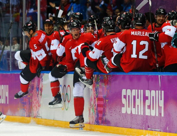 Canada's players celebrate their men's ice hockey semi-final victory over the US.