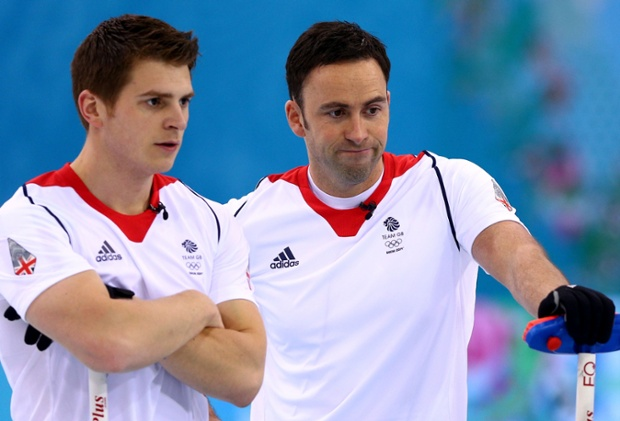 Scott Andrews and David Murdoch of Great Britain watch the Curling Gold Medal slip away in their match against Canada.