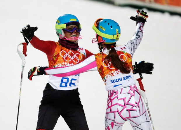 Sisterly support as Iran's Forough Abbasi, left, and Lebanon's Jacky Chamoun embrace after finishing the second run of the women's slalom.