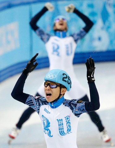 Victor An of the winning Russian team celebrates after they won the men's 5,000 metres short track speed skating final relay race.