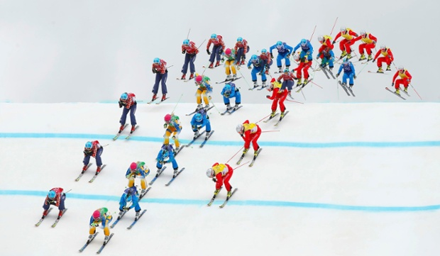 Sweden's Anna Holmlund (green bib), Canada's Kelsey Serwa (red bib), Austria's Katrin Ofner (blue bib) and Switzerland's Fanny Smith (yellow bib) compete during the women's freestyle skiing skicross semi-finals.