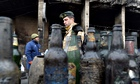 A man walks past empty Molotov cocktail bottles on Kiev's Independence Square.