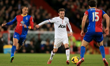 Juan Mata searches in vain for a way through the Palace midfield.
