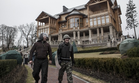 People and protesters roam the garden in front of the mansion of former Ukrainian President Viktor Yanukovych's residency in Mezhygirya, near Kiev.
