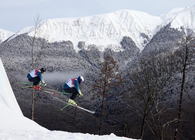 Anton Grimus and Scott Kneller of Australia jump during a ski cross training session.