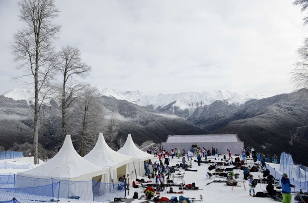 Athletes prepare for the men's snowboard parallel giant slalom event.