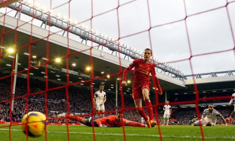 Jordan Henderson follow in his own saved shot to score Liverpool's fourth goal.