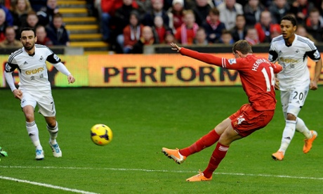 Jordan Henderson scores his first and Liverpool's second in their game against Swansea at Anfield.