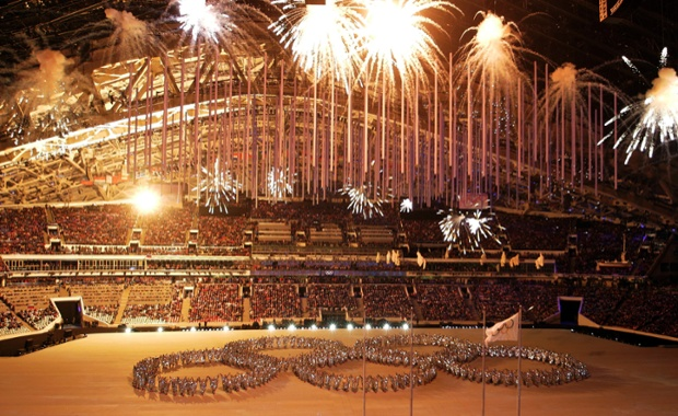 Fireworks light up the arena as artists make a formation in the shape of the Olympic Rings during the closing ceremony of the 2014 Winter Olympics.