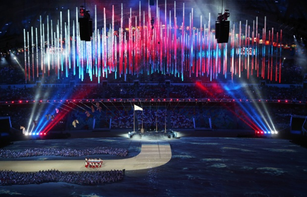 The Russian flag is brought into the arena by Russian athletes during the 2014 Sochi Winter Olympics Closing Ceremony at Fisht Olympic Stadium on February 23, 2014 in Sochi, Russia.