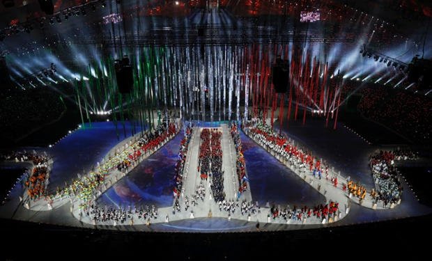 Athletes arrive during the closing ceremony of the 2014 Winter Olympics in Sochi, Russia.