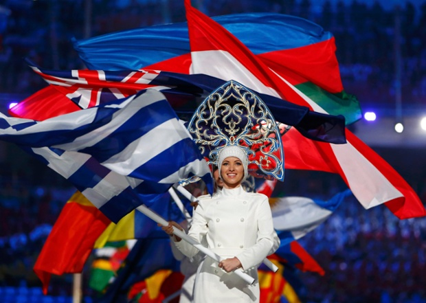 Flagbearers arrive holding their national flags in the closing ceremony for the Sochi 2014 Winter Olympic Games.