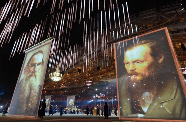 Performers stand next to giant portraits of famous Russian writers during the Closing Ceremony of the Sochi Winter Olympics at the Fisht Olympic Stadium.