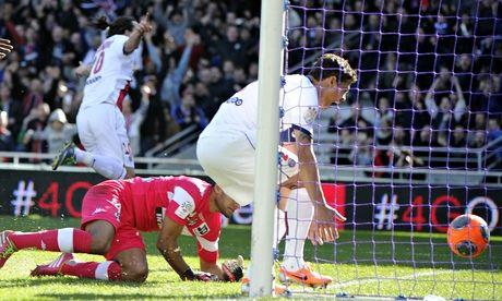 Paris Saint-Germain's Zlatan Ibrahimovic celebrates a goal past Toulouse's Zacharie Boucher