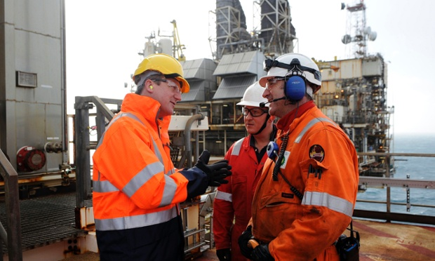 David Cameron (left) talks with workers during a visit to the BP Etap platform (Eastern Trough Area Project) in the North Sea, around 100 miles east of Aberdeen, Scotland.
