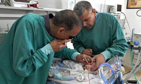 slam al-Hashash and a colleague treat a baby in West Bank eye unit