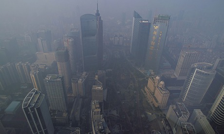 Buildings are seen through thick haze in Guangzhou