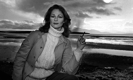 Charlotte Rampling smoking a cigarette (or weed)