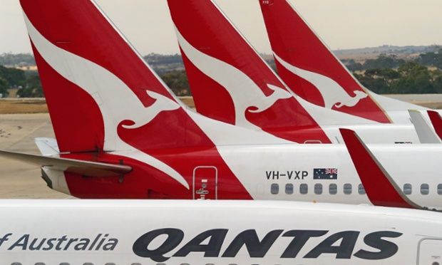 Qantas aeroplanes wait at Melbourne Tullamarine Airport on February 25, 2014 in Melbourne, Australia. On Thursday Qantas will announce their half year results, media reports suggest part of those announcements will include a large number of job cuts and the sale of their Melbourne terminal.