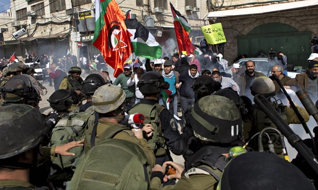 Israeli soldiers and Palestinian protesters in Hebron