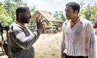 Steve McQueen directs Chiwetel Ejiofor on the set of 12 Years a Slave.