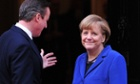 British Prime Minister David Cameron greets German Chancellor Angela Merkel outside 10 Downing Street.