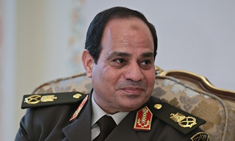 General Abdel Fatah el-Sisi, sitting down