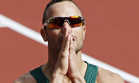 Oscar Pistorius on track at London Olympics, hands together as if in prayer, he looks at scoreboard