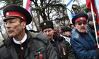 Pro-Russian Cossacks rally outside the Crimean parliament building in Simferopol, Ukraine