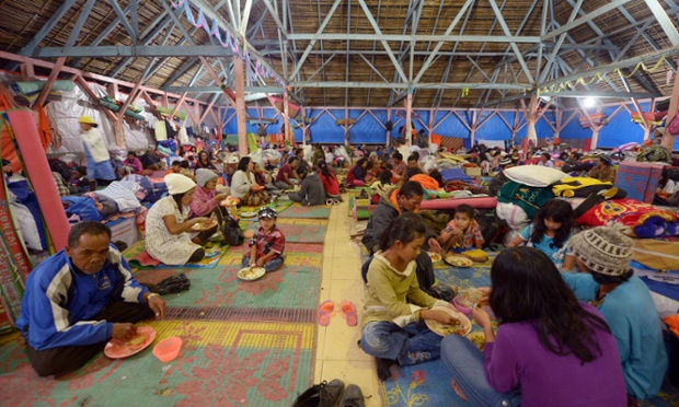 Villagers have dinner at a temporary shelter in Karo