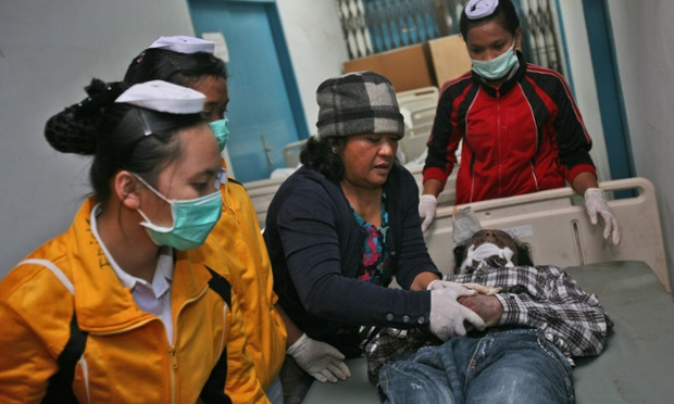 Nurses tend a victim at a hospital in Kabanjahe