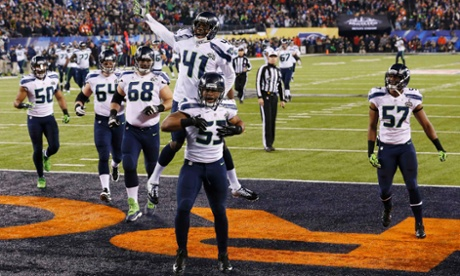 Seattle Seahawks Malcolm Smith celebrates an interception touchdown with Byron Maxwell against the Denver Broncos in Super Bowl XLVIII