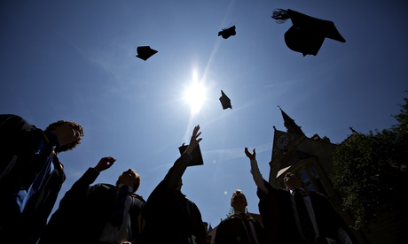 Graduates celebrate throwing hats into the air